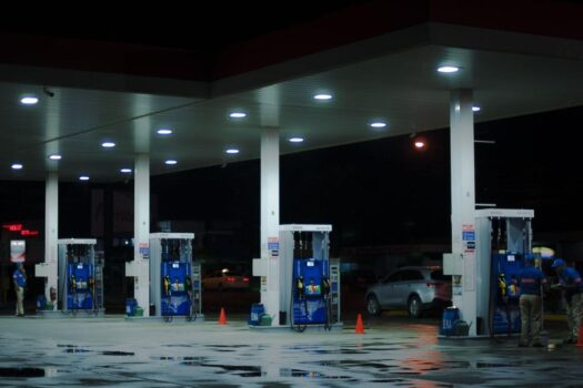 A modern gas station at night time.